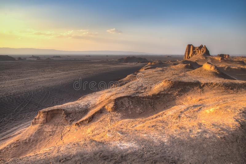 Sunset at the Dasht-e Lut desert near Kerman, Iran. Sunset at the magnificent Dasht-e Lut deserts, famous for its rock formations called Kaluts or Kalouts near royalty free stock photos