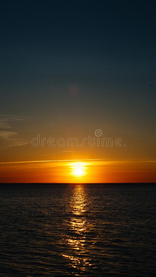 Sunset or dawn at sea. Black Sea shore. Mobile Screensaver, Vertical Layout, Nature Wallpaper. Beautiful Colors, Marine Theme royalty free stock photos