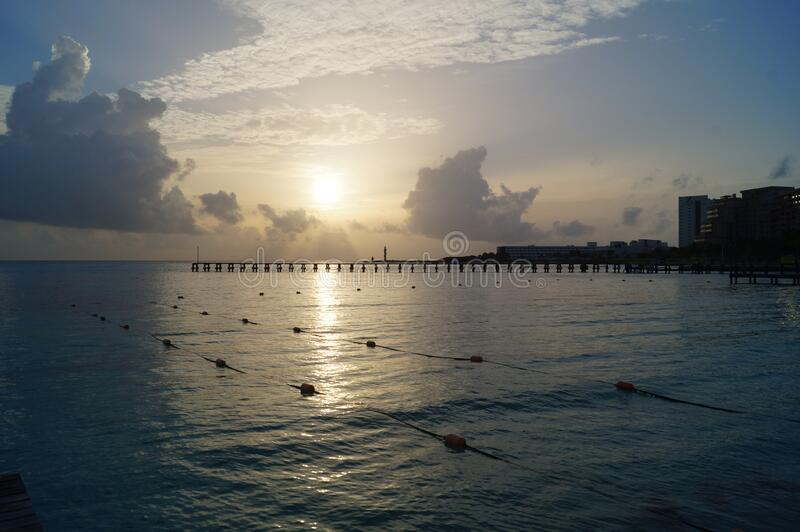 Sunset on a delightful city beach. Cancun, Mexico. Sunset on a delightful city beach. Cancun, Quintana Roo, Mexico royalty free stock photo