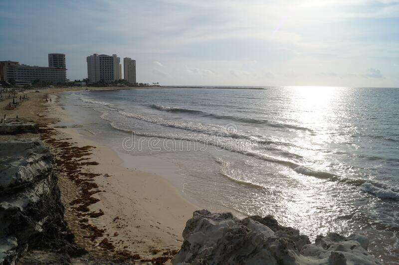Sunset on a delightful city beach. Cancun, Quintana Roo, Mexico. Architecture of the modern city of Cancun. View of Cancun city. Cancun is a city in royalty free stock photos