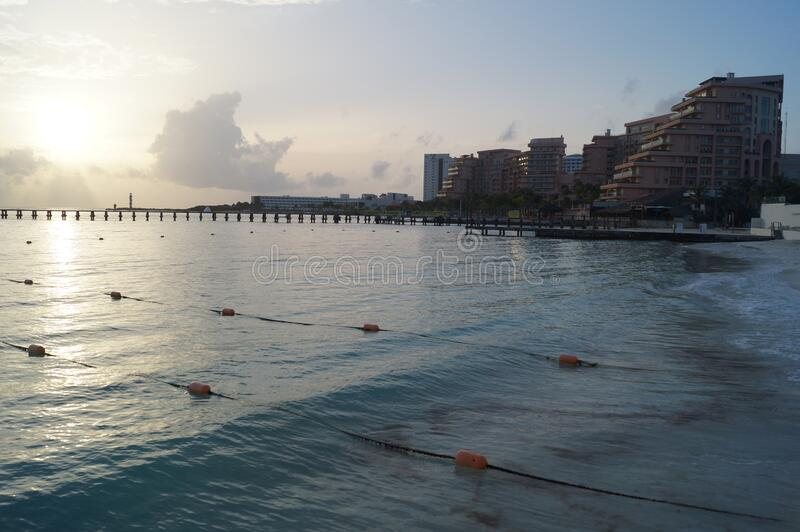 Sunset on a delightful city beach. Cancun, Mexico. Sunset on a delightful city beach. Cancun, Quintana Roo, Mexico stock image