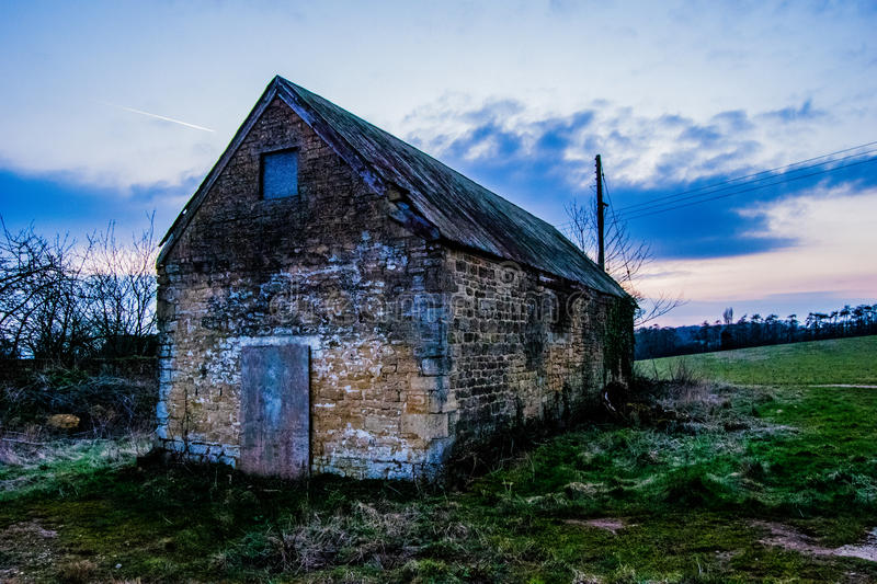Sunset at the derelict barn royalty free stock photography