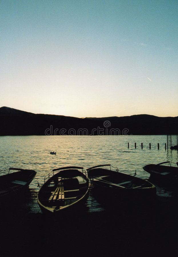 Sunset on Derwent Water. Two Boats on Derwent Water in the Lake District stock photo