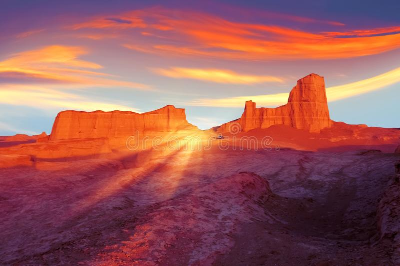 Sunset in the desert of Iran. Alien planet concept. Ultraviolet, blue, orange, red and yellow artistic image stock photos