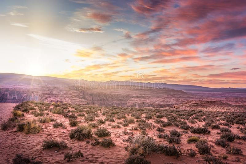Sunset on desert landscape with a natural bridge in Southern Utah stock image
