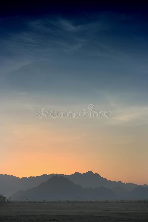 Sunset in Desert - Rocky Mountains. In a distance stock images
