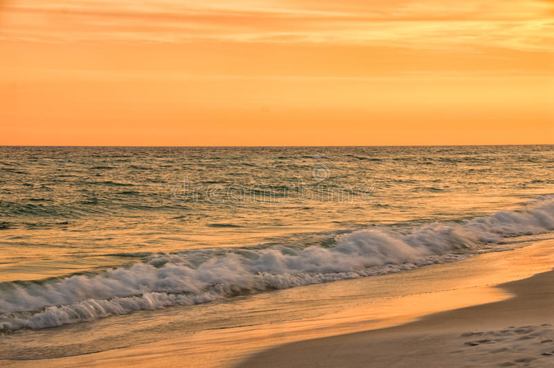 Sunset at Destin Beach Florida USA in Warm Brilliant Tones stock images