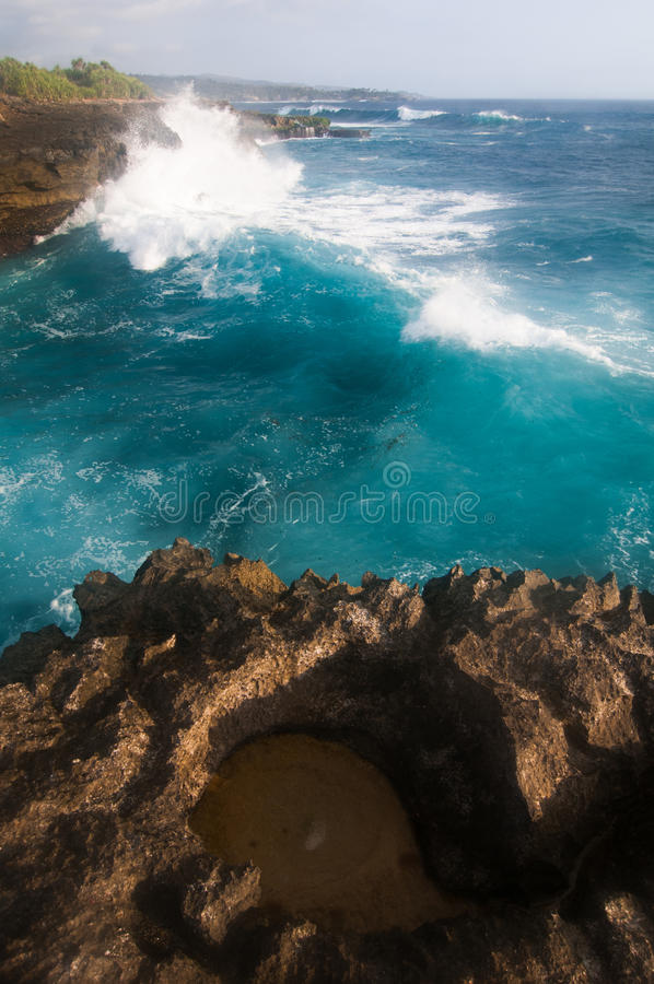 Sunset on Devil's tear. Landmark of small island Nusa Lembongan, Indonesia royalty free stock photography
