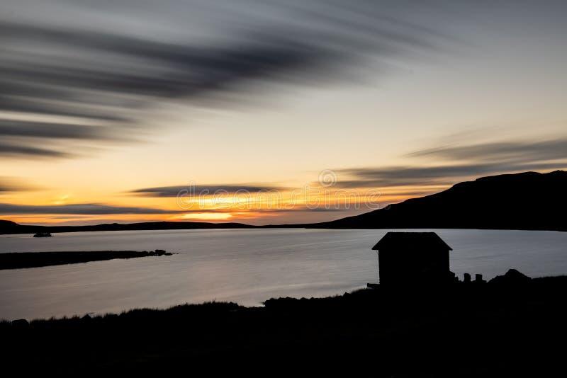 Silhouette of boat house, Devoke Water, Sunset royalty free stock photo