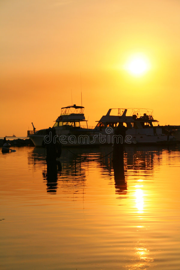 Sunset dock. Sunset by the bay in manila stock photos