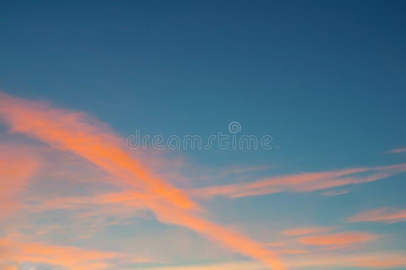 Sunset dramatic sky - orange dramatic colorful clouds lit by evening sunset light. Vast sunset sky landscape scene royalty free stock image