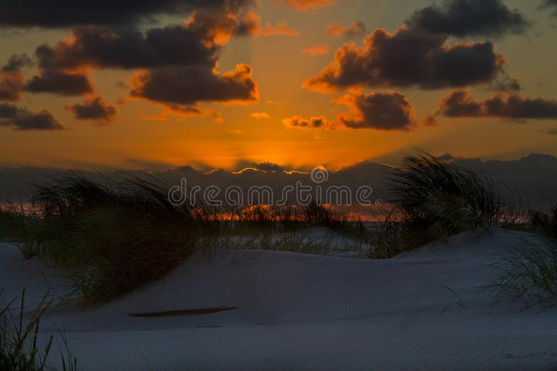 Sunset in dune landscape. Dunes and Beachgrass just after sunset under a red sky stock photo
