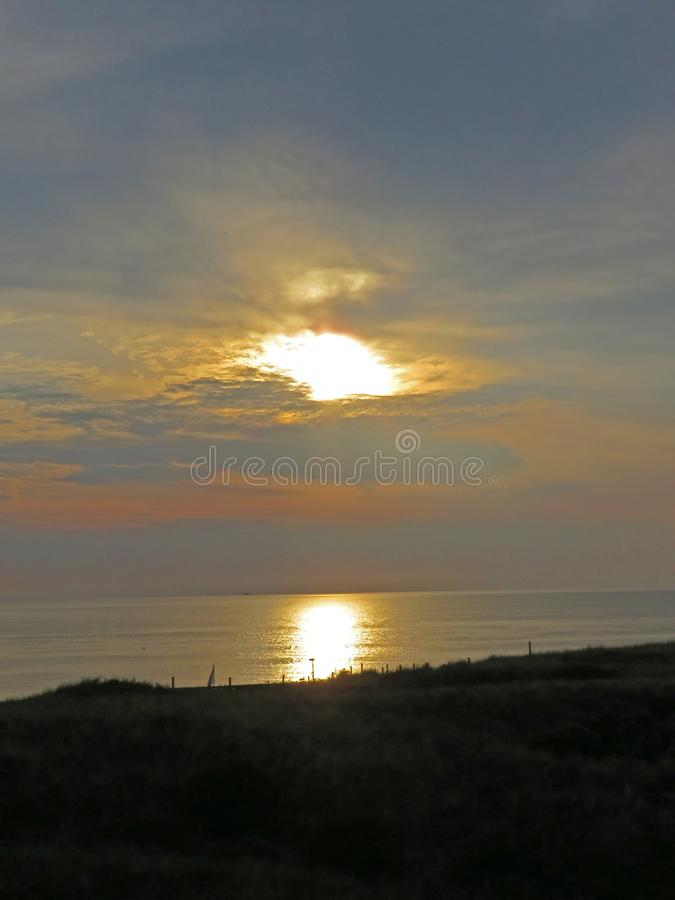 Sunset at the dutch coast. See the sun set at the dutch coast. Magical moment stock photography