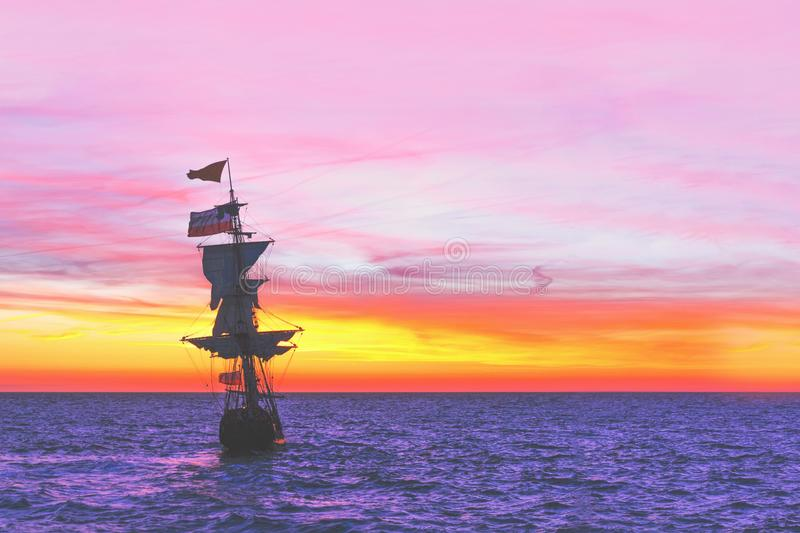 Sunset on the Dutch Pirate Ship. Pirate Ship leaving the harbor at the sunset for a long campaign against the loyal marines suitable for iPhone X format