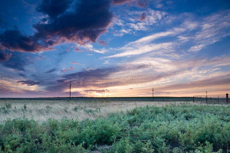 Sunset in Eastern Plains Colorado. A pink and purple sunset behind fields in eastern plains Colorado stock image