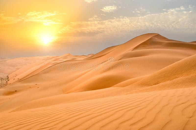 Sand Dunes in Arabian Desert at Sunset royalty free stock image