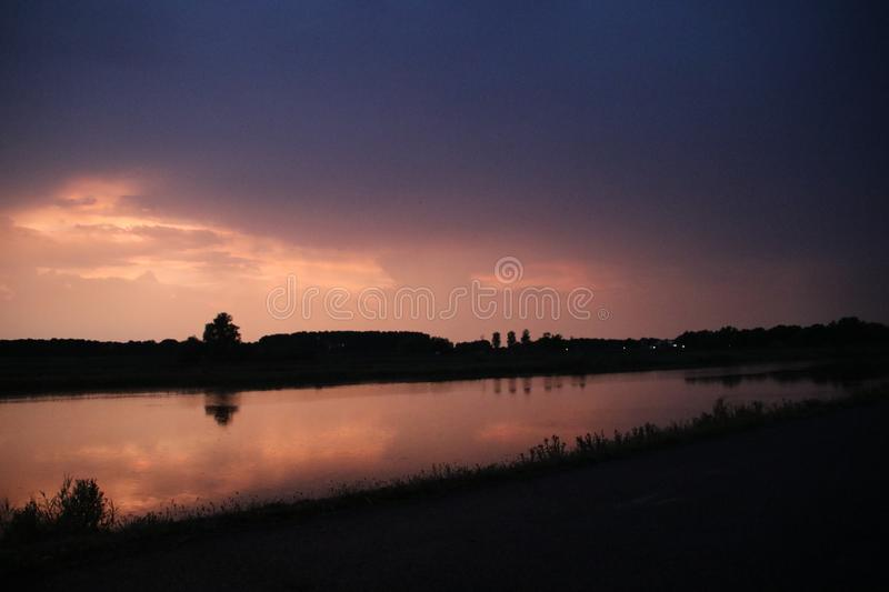 Sunset in the Eendragtspolder in Zevenhuizen, used for water storage from river Rotte to protect Rotterdam against flooding.. Sunset in the Eendragtspolder in royalty free stock photos
