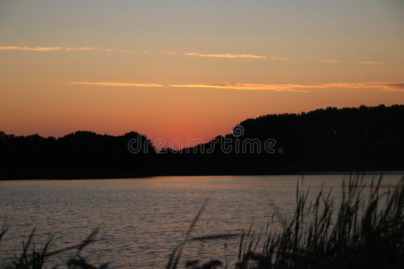Sunset in the Eendragtspolder in Zevenhuizen, used for water storage from river Rotte to protect Rotterdam against flooding.. Sunset in the Eendragtspolder in stock photo