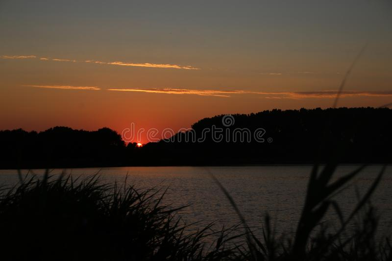 Sunset in the Eendragtspolder in Zevenhuizen, used for water storage from river Rotte to protect Rotterdam against flooding.. Sunset in the Eendragtspolder in stock images