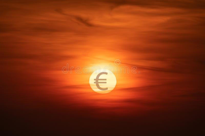 Sunset with EUR symbol on the Sun. Falling currency concept. stock photos
