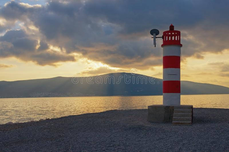 Sunset, evening landscape with rays of light through the clouds. Montenegro, Bay of Kotor. Sunset, evening landscape with rays of light through the clouds. Red royalty free stock image