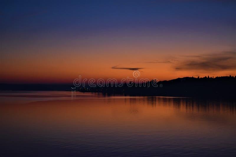 Sailing away at Sunset stock image