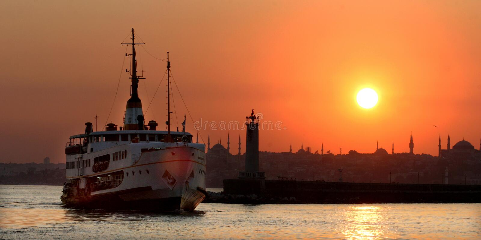 Sunset in Istanbul historical peninsula and ferryboat royalty free stock image