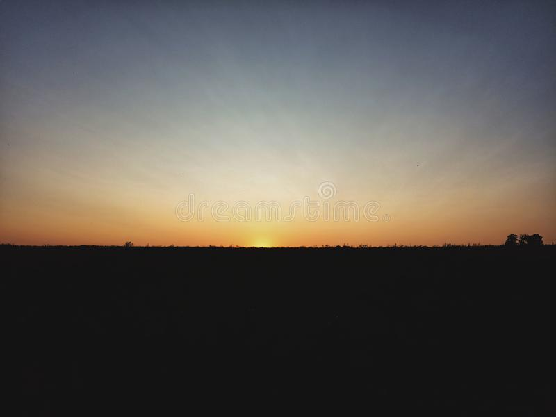 Sunset at fields royalty free stock photo