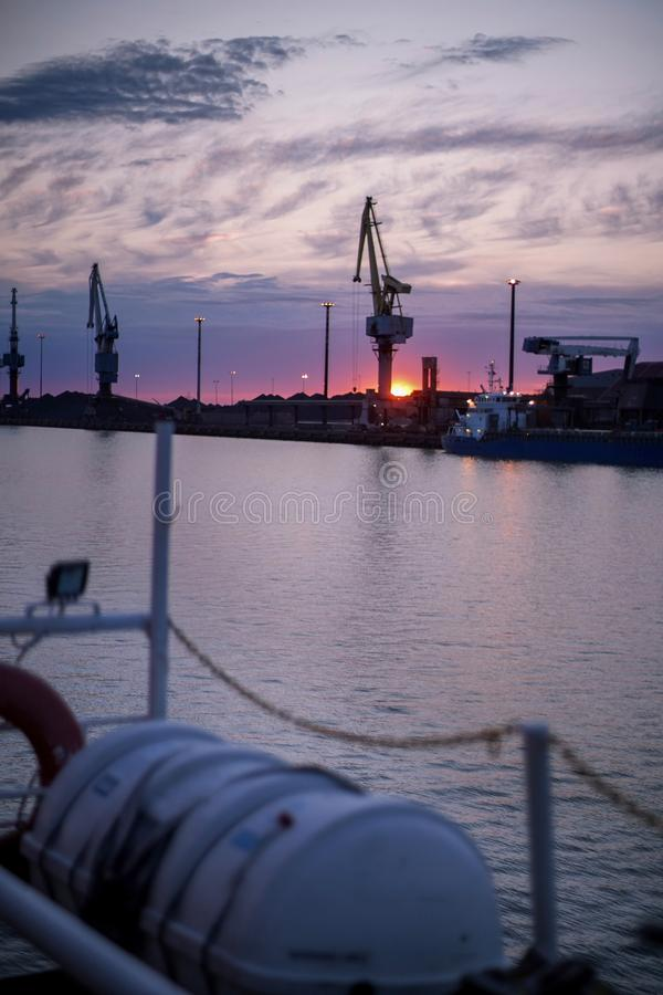 Sunset in Finland. Bulk port. White nights in Bothnia Sea. North of Finland. Summer time. Midnight. Sunset in Finland. Bulk port. White nights in Bothnia Sea stock photos