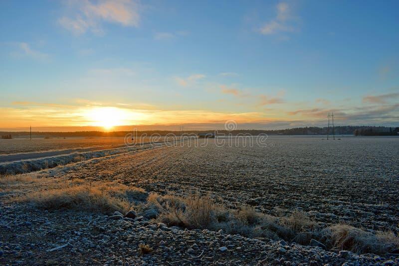 Sunset on Finnish countryside. Sunset on December in Finnish countryside stock photo