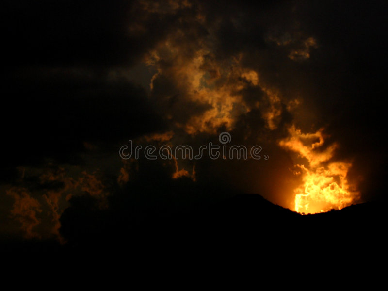 Sunset Fire. A sunset with proper cloud formations look like a volcanic fire in mountains stock photos