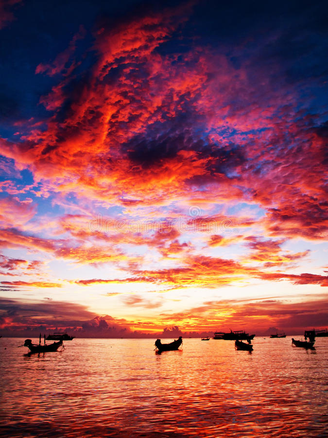 Sunset of fire. Sunset in Thailand, spectacular red fire colored clouds