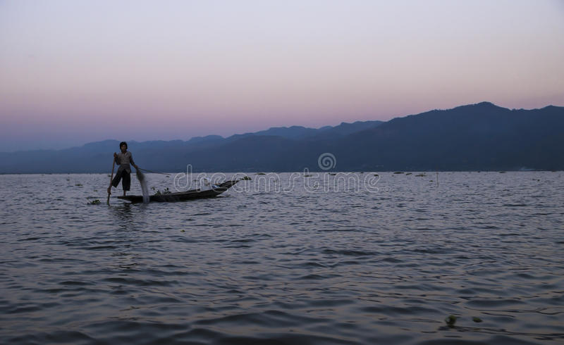Sunset fisher. Fisher man after sunset at Inle lake, Myanmar royalty free stock photo