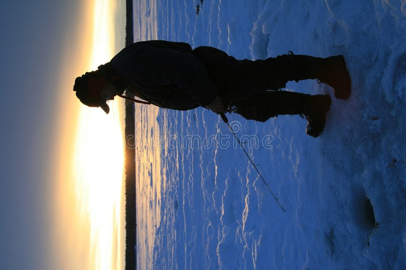 Download Sunset Fisherman stock photo. Image of silhouette, snow - 4024606