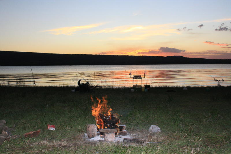 Sunset, fishing, campfire, the perfect therapy royalty free stock photo