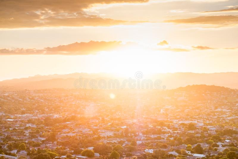 Sunset with flare over the mountain and town city in Auckland, New Zealand. I. Sunset with flare over the mountain and town city in Auckland, New Zealand royalty free stock images