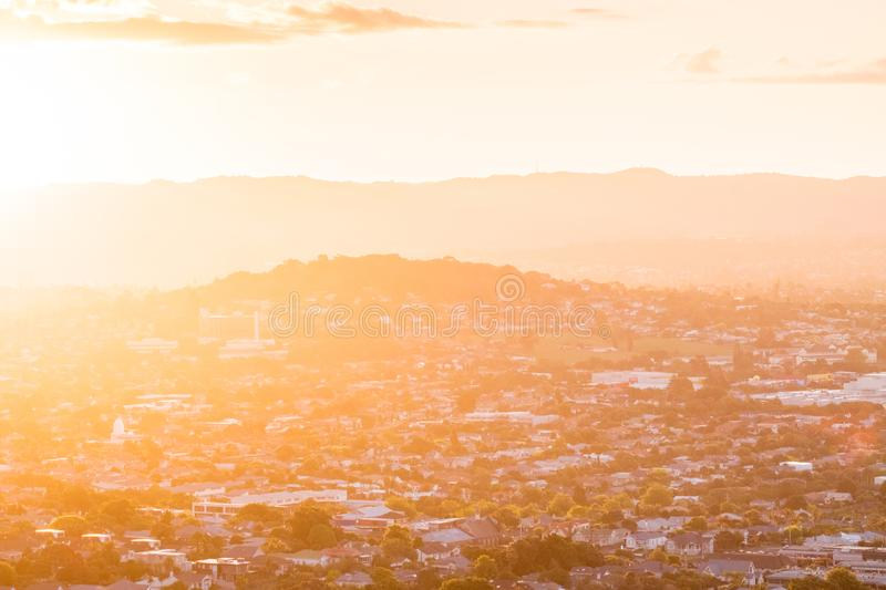 Sunset with flare over the mountain and town city in Auckland, New Zealand. I. Sunset with flare over the mountain and town city in Auckland, New Zealand stock photography