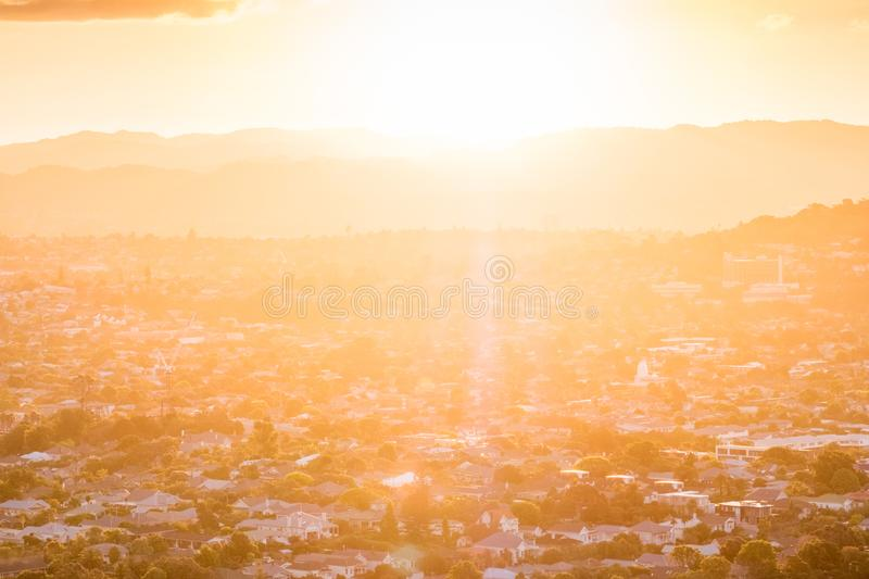 Sunset with flare over the mountain and town city in Auckland, New Zealand. I. Sunset with flare over the mountain and town city in Auckland, New Zealand royalty free stock image