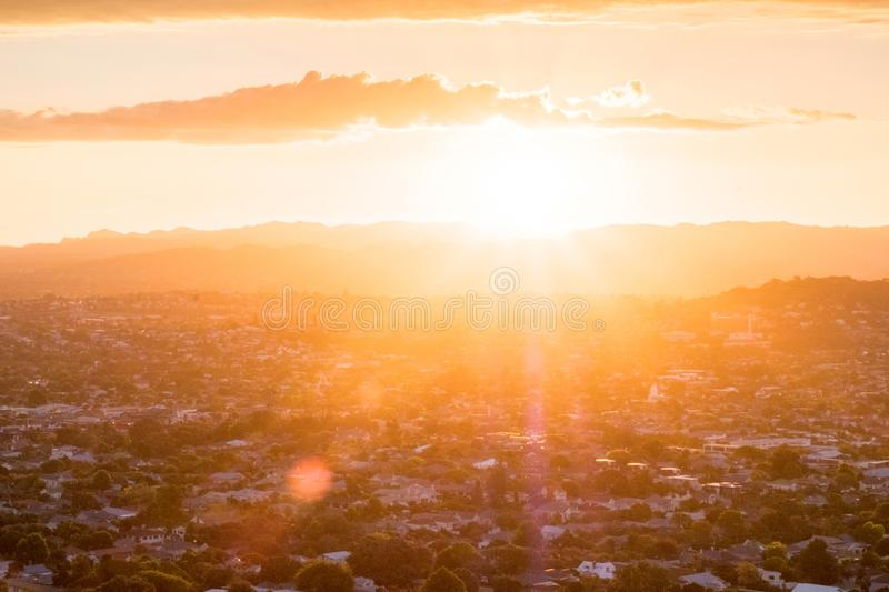 Sunset with flare over the mountain and town city in Auckland, New Zealand. I. Sunset with flare over the mountain and town city in Auckland, New Zealand stock image