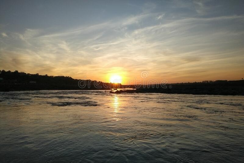 A sunset with flowing water royalty free stock image