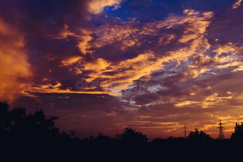 Sunset fluffy clouds sky purple red orange blue colors dusk. Cloudscape stock images
