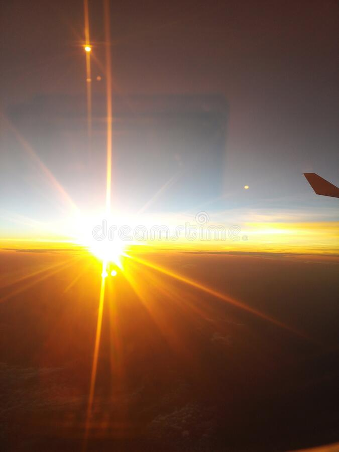 Sunset from a flying aircraft stock photography