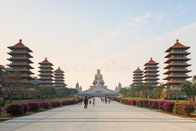 Sunset at Fo Guang Shan buddist temple of Kaohsiung, Taiwan with many tourists walking by. stock photos