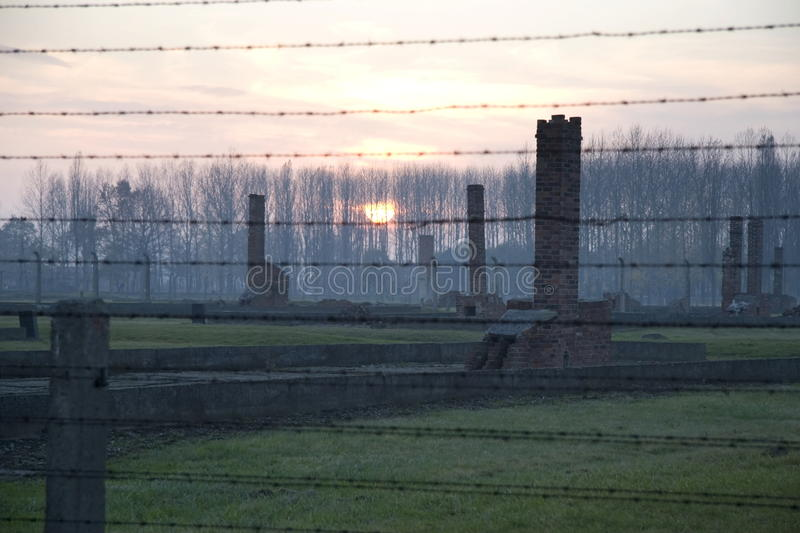 Sunset in the former death camp, Auschwitz-Birkenau. Poland royalty free stock images