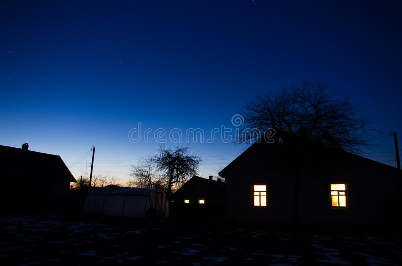 Frosty evening in village. royalty free stock photos