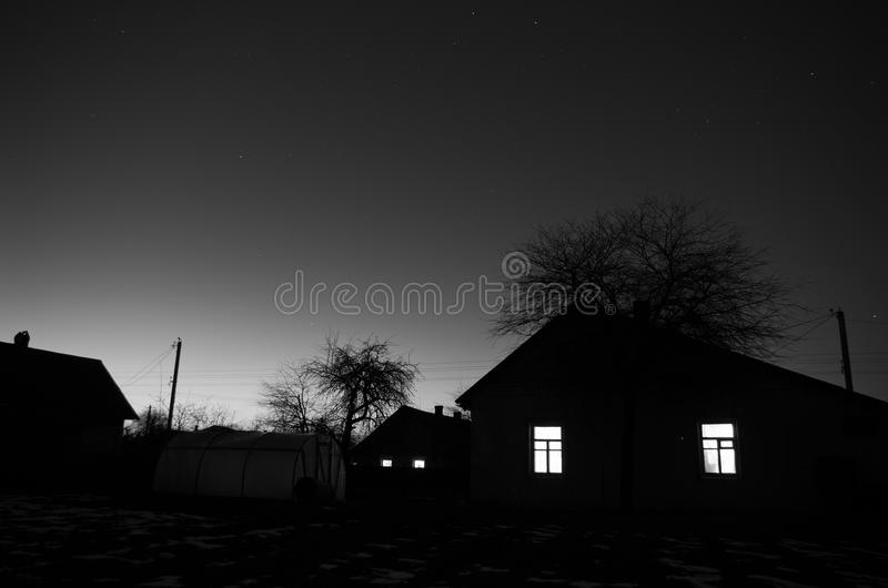 Frosty evening in village. royalty free stock photo