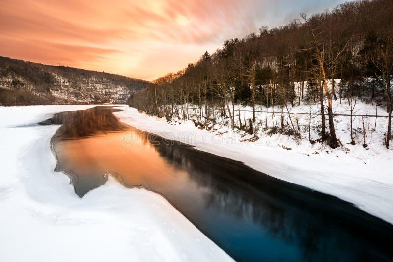 Sunset on a frozen Delaware river. Near Pond Eddy, New York stock image
