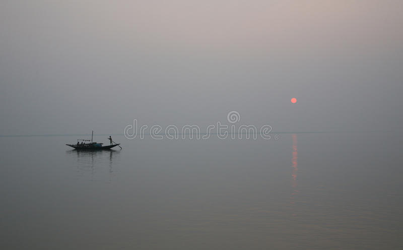 Sunset, Ganges delta. A stunning sunset looking over the holiest of rivers in India. Ganges delta in sunderbands, West Bengal, India stock image