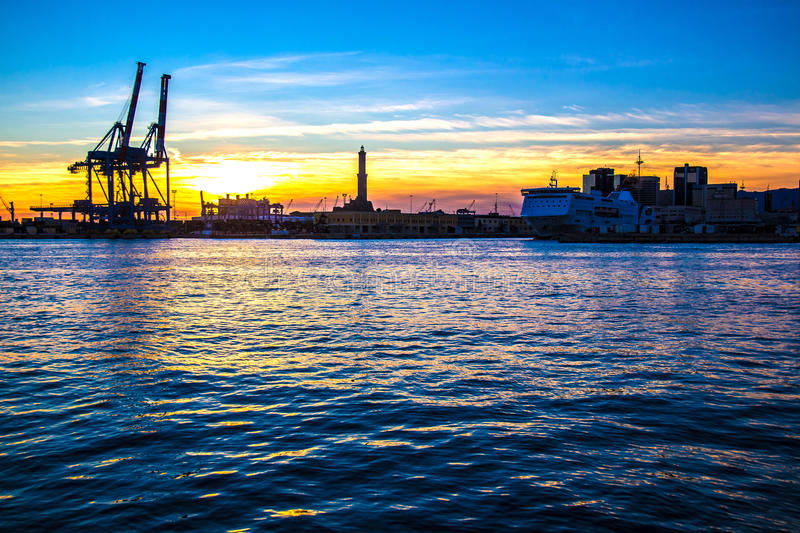 Sunset at Genoa`s port, silhouette of the Lanterna, Italy royalty free stock image