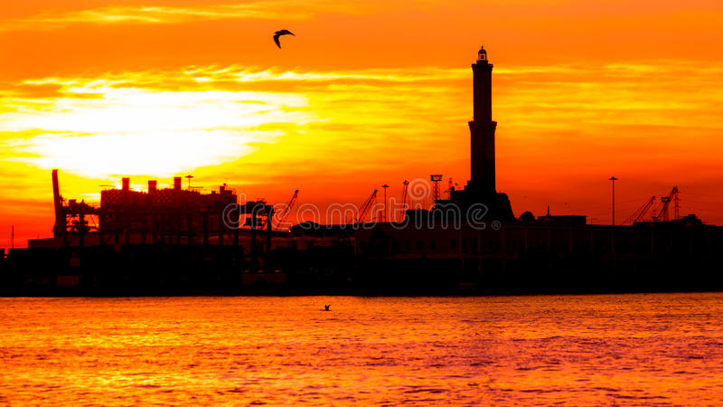Sunset at Genoa`s port, silhouette of the Lanterna, Italy royalty free stock images